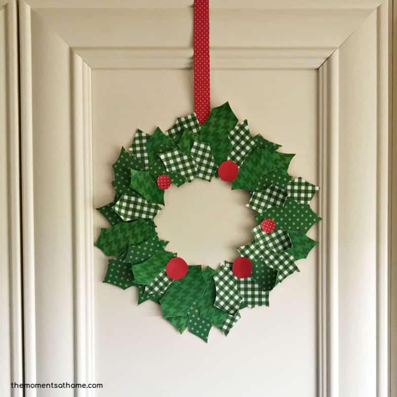 Scrapbook paper Christmas wreath craft.