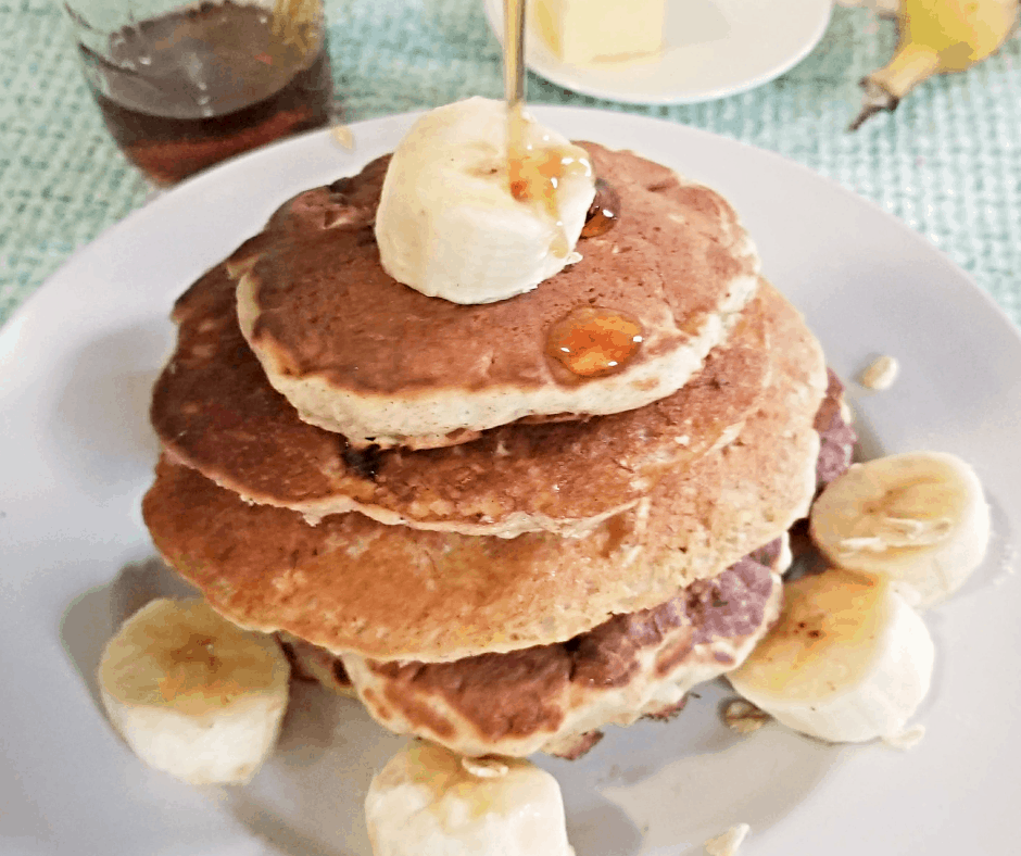 stack of oatmeal banana pancakes with syrup