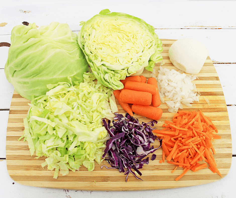 Picture of fresh cabbages, carrots, onion to make paleo pineapple coleslaw