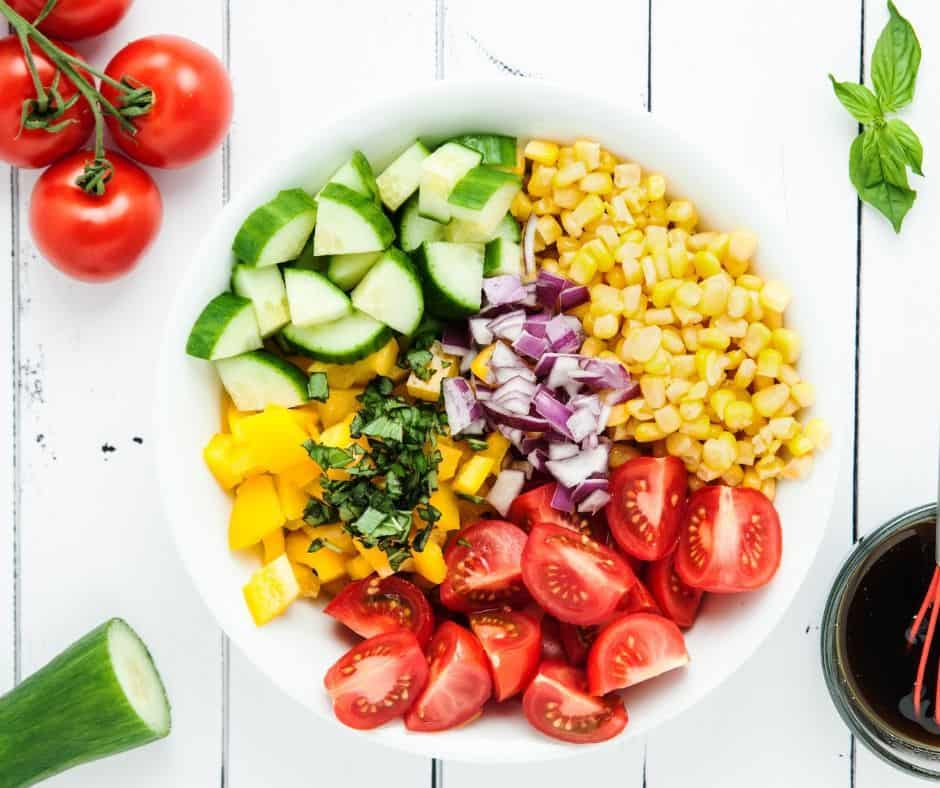 summer corn salad in a white bowl ready to enjoy