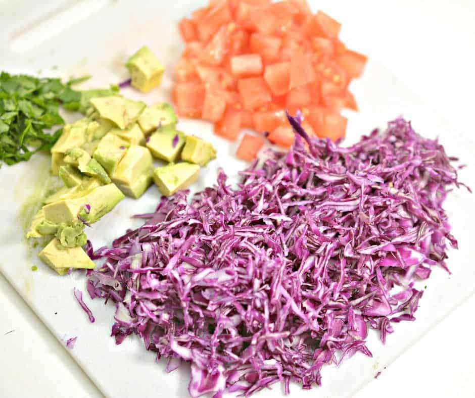 diced tomatoes, avocados, and purple cabbage for keto shrimp taco slaw