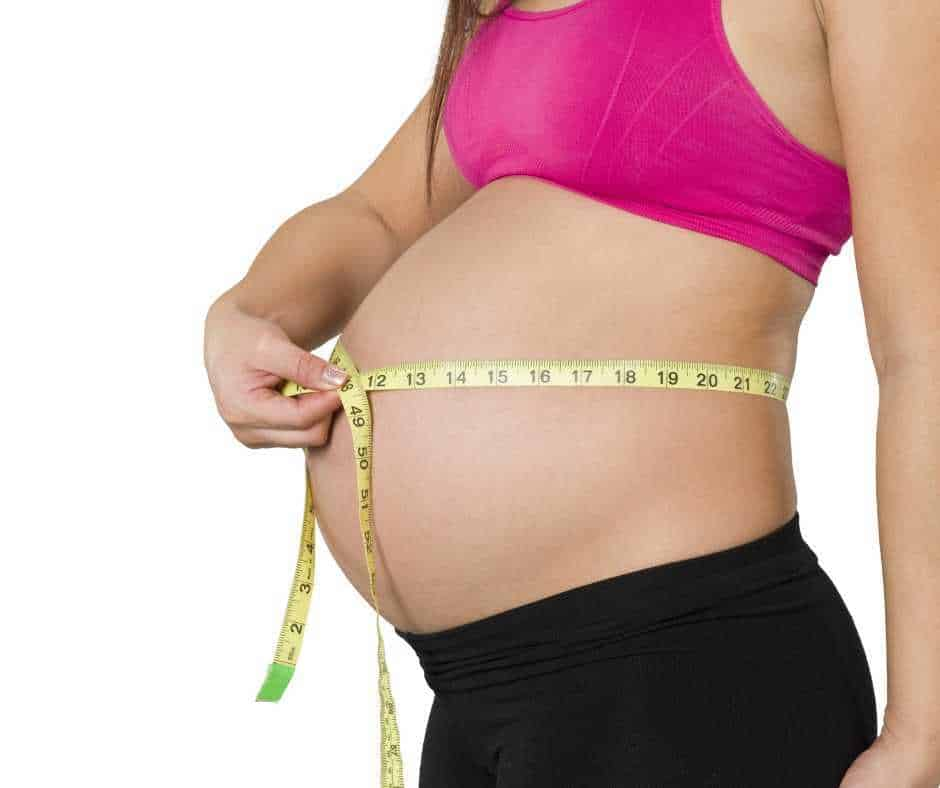 pregnant belly with woman exercising