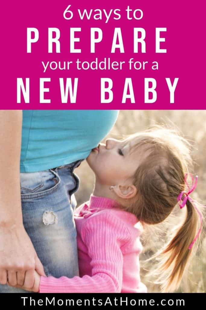 6 ways to prepare your toddler for a new baby in the family; toddler kissing baby from The Moments At Home