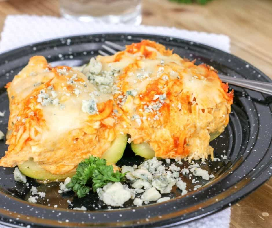 zucchini boats stuffed with keto buffalo chicken dip on a plate
