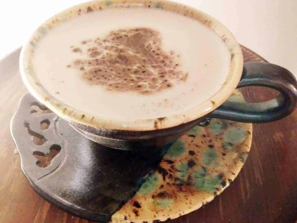 cup of cappuccino with caramel flavoring in a porcelain mug
