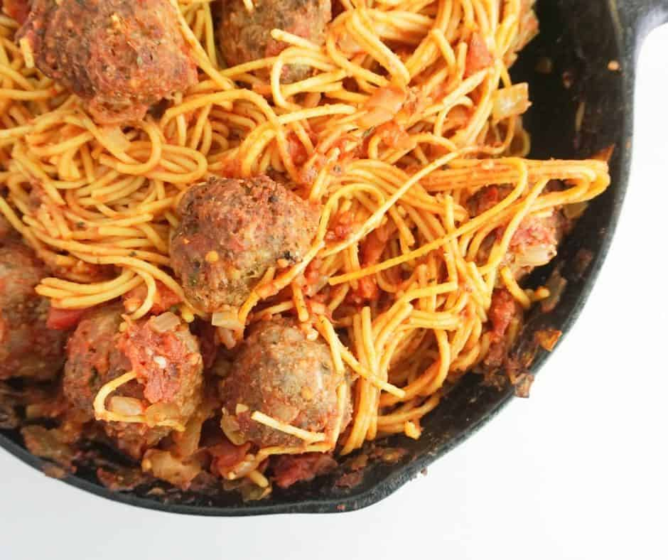 spaghetti and meatballs in a skillet