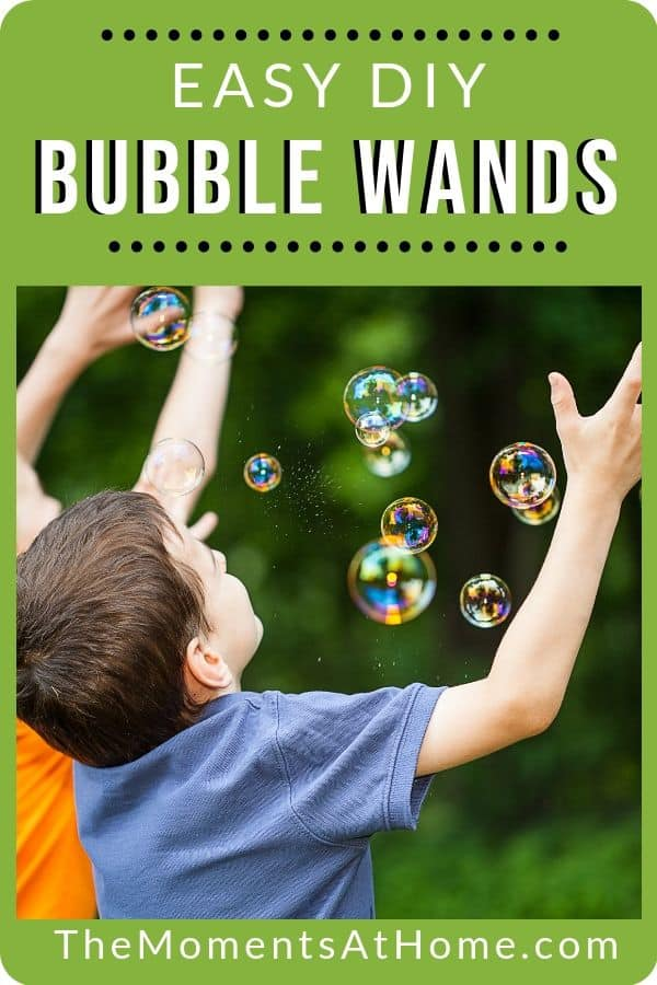 """boys catching bubbles outside with words """"easy DIY bubble wands"""" from The Moments At Home"""