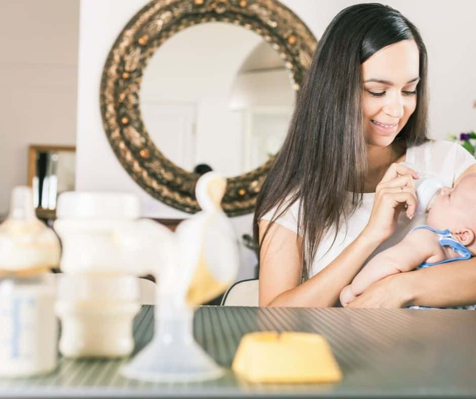 mother pumping and feeding her baby breastmilk from a bottle