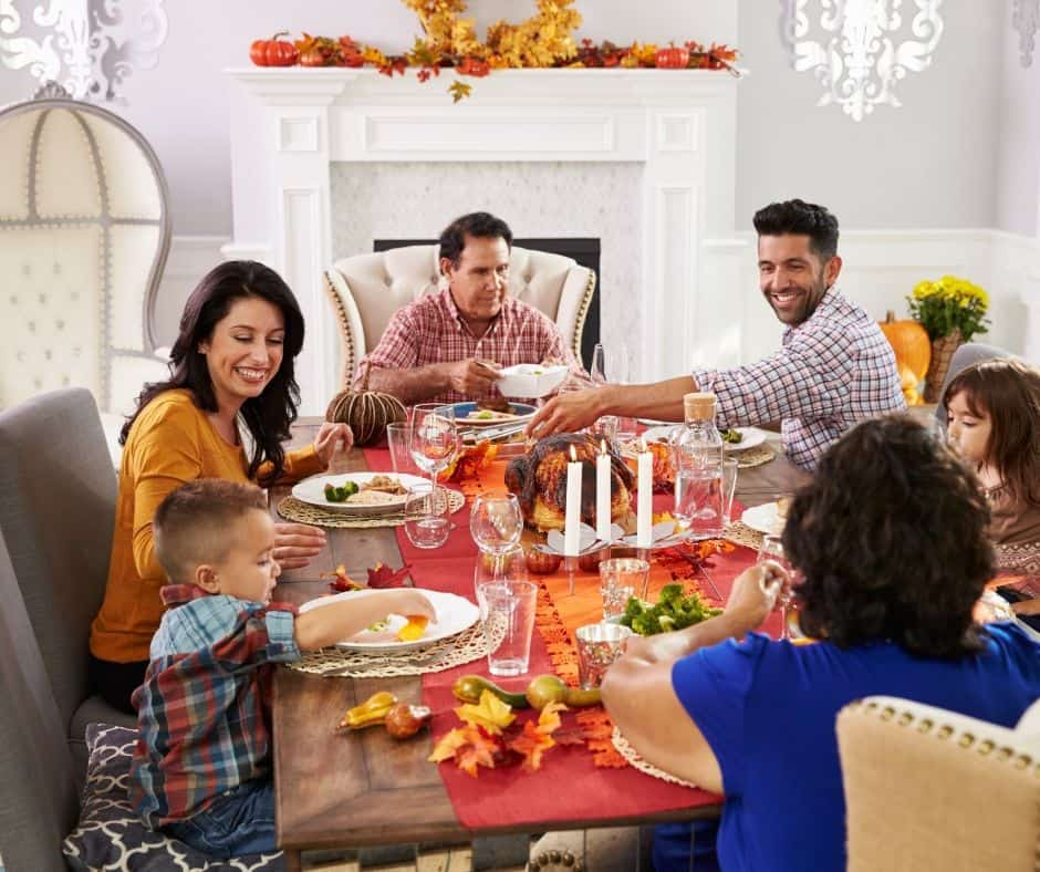 happy family at traditional thanksgiving table
