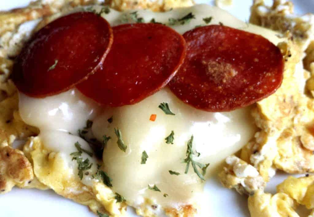 eggs with melted mozzarella and crispy pepperoni for a pizza omelette