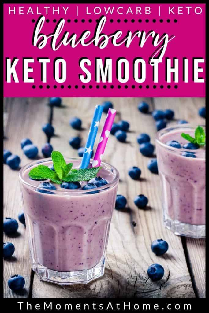 """blueberries on wood with two blueberry cheesecake keto smoothies in glasses with text """"blueberry keto smoothie"""" by The Moments At Home"""