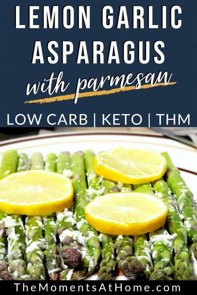 roasted asparagus topped with lemon rounds and parmesan cheese  by The Moments At Home