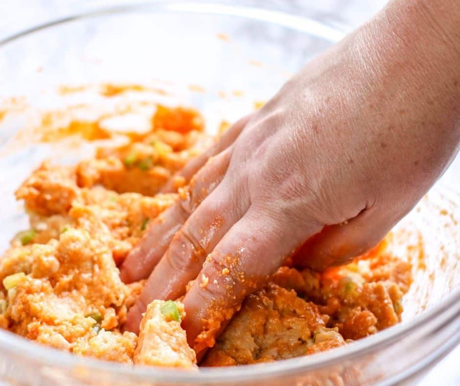 mixing the meat for low carb buffalo chicken meatballs