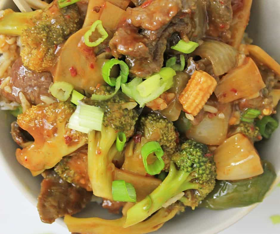 close up picture of Asian vegetables and Chinese Hunan chicken in a spicy garlic sauce