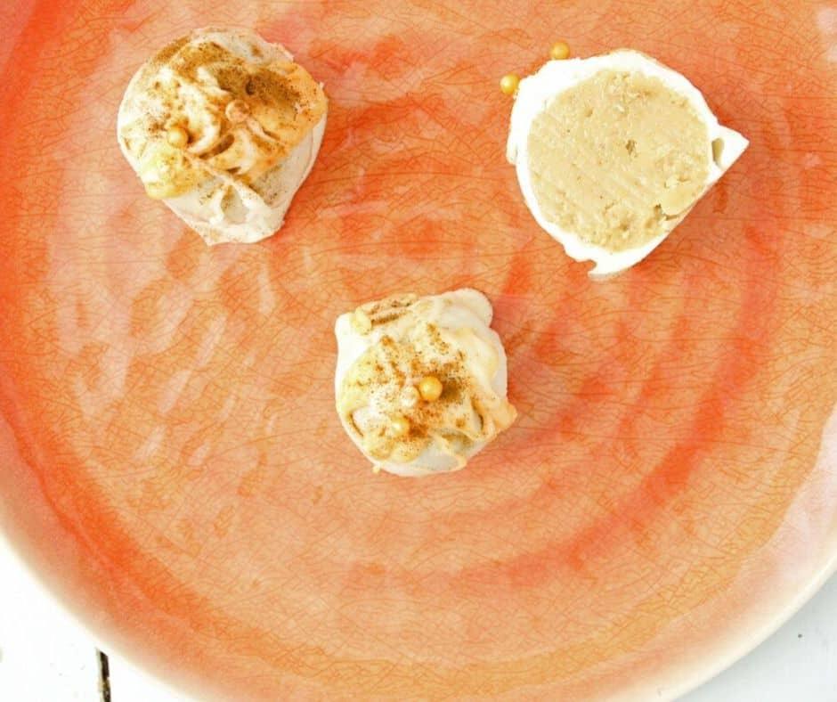 pumpkin spice keto truffles on an orange plate