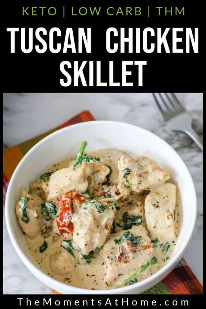 """bowl of keto tuscan chicken with garlic cream sauce, tomato, basil or spinach, and bacon with text """"tuscan chicken skillet: keto, low carb, THM"""" by The Moments At Home"""