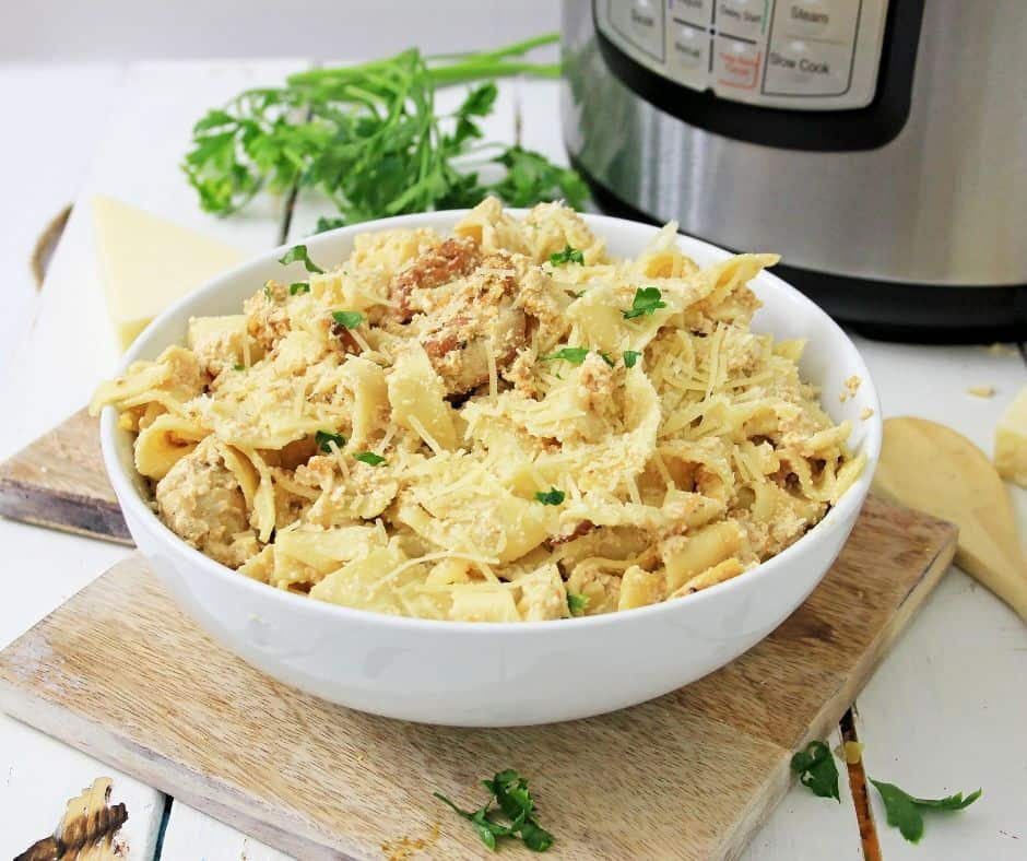 bowl of chicken fettuccine Alfred in front of the instant pot