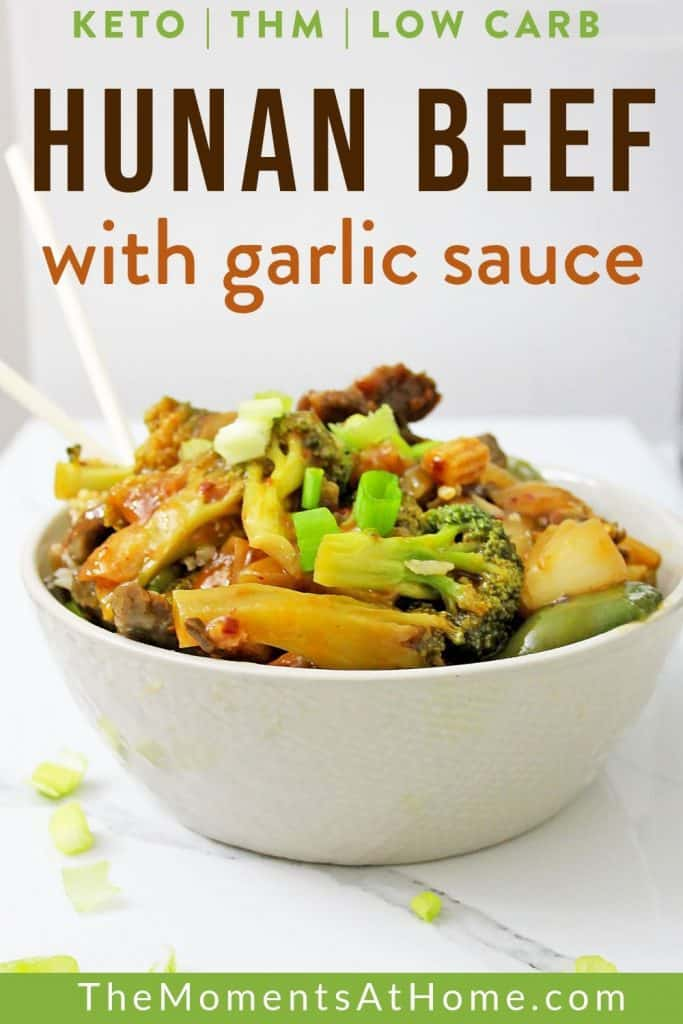 white bowl and chopsticks filled with low carb Hunan beef with garlic sauce and vegetables