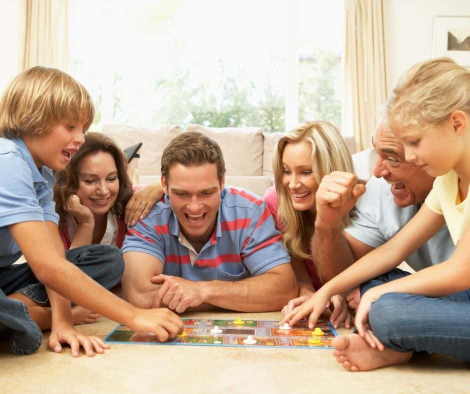 family playing board game together and having fun