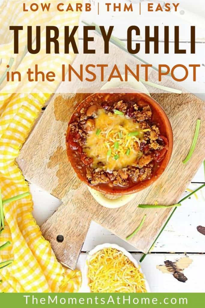 bowl of instant pot turkey chili made as a THM S low car with cheese on top