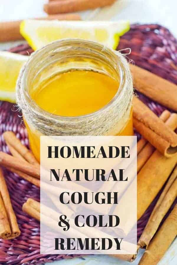 """homemade natural cough and Cold' text over pic of jar with remedy in it lemon honey cinnamon"