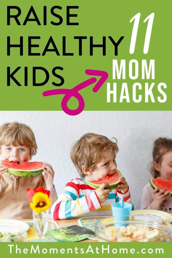 """kids eating fruit with text """"raise healthy kids with these 11 mom hacks"""" by The Moments at Home"""