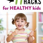 """picture of toddler eating veggies with a smile and text """"11 Mom Hacks for HEALTHY kids"""" by The Moments At Home"""