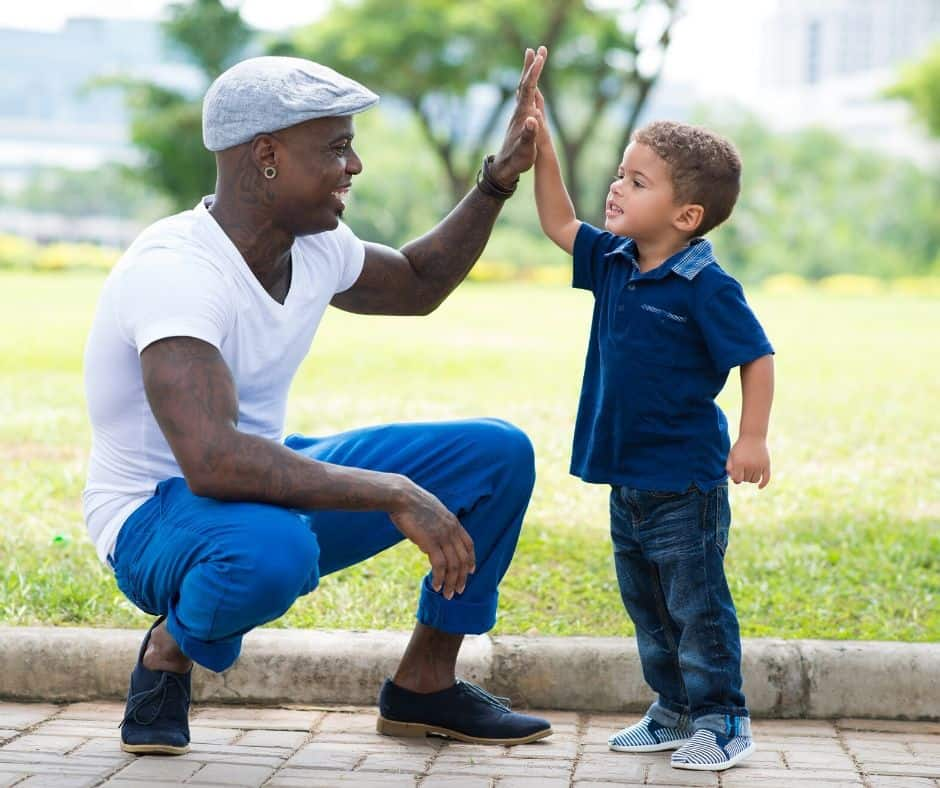 dad and son high fiving; celebrating goal setting